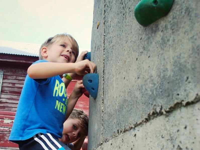 Kids on climbing wall at Treinen Farm