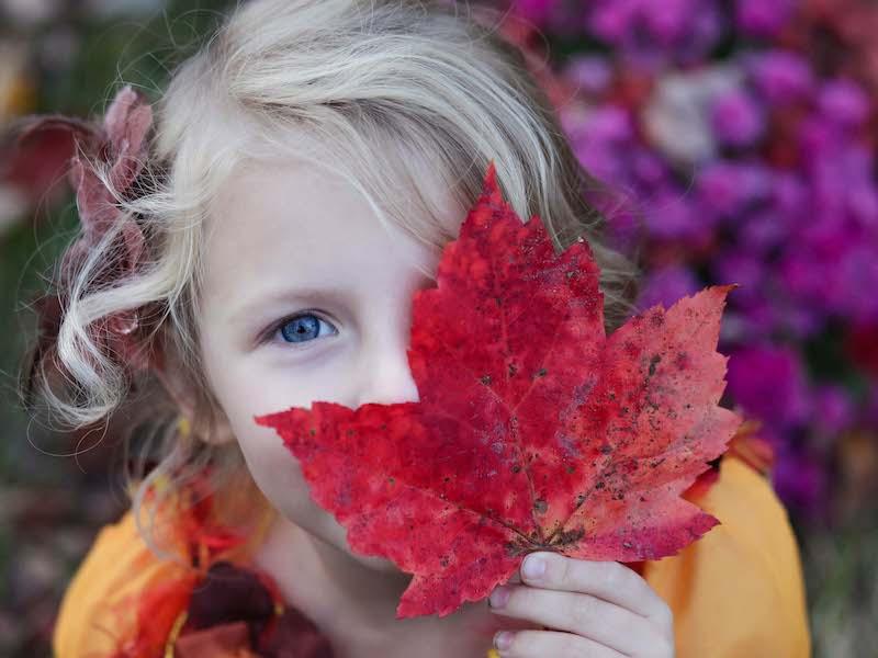 Girl with leaf at Treinen Farm Corn Maze and Pumpkin patch