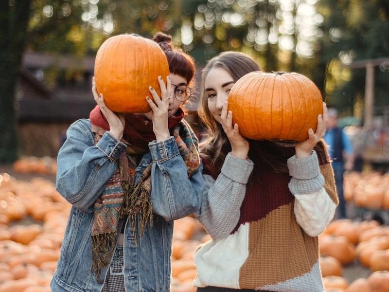Women with pumpkins at Treinen Farm Pumpkin Patch