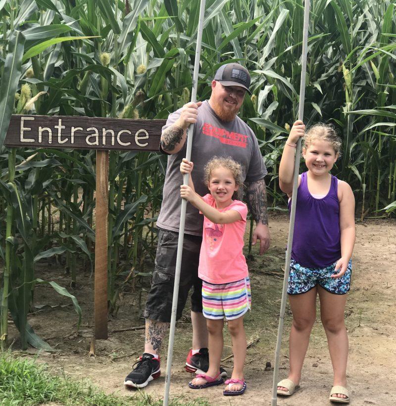 Proud family finishes corn maze